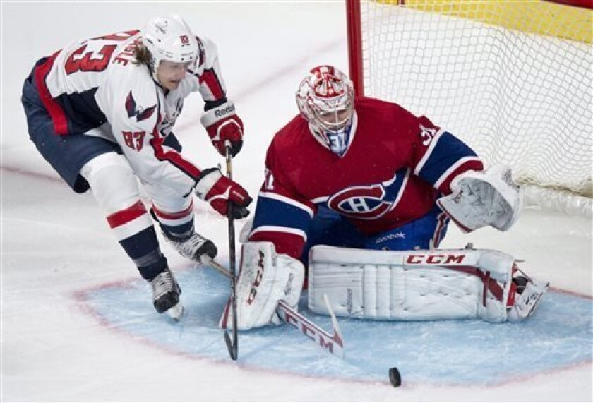 Montreal Canadiens goalie Carey Price makes the save off Washington Capitals' Jay Beagle during first period NHL hockey action Tuesday, April 9, 2013 in Montreal. (AP Photo/The Canadian Press, Paul Chiasson)
