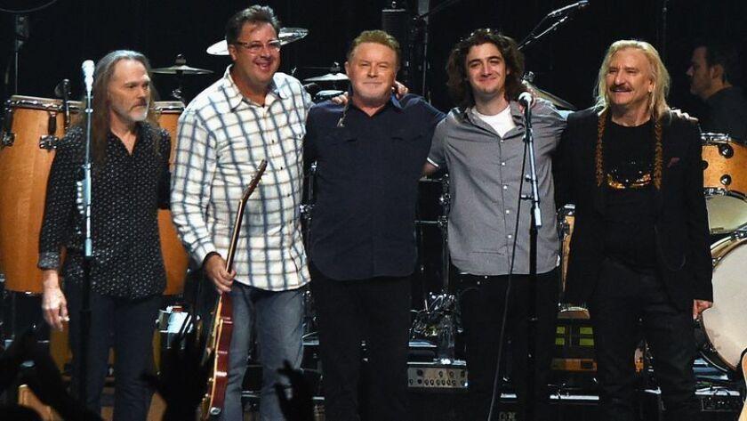 Timothy Schmit, left, Vince Gill, Don Henley, Deacon Frey and Joe Walsh at a 2017 Eagles concert in Nashville.