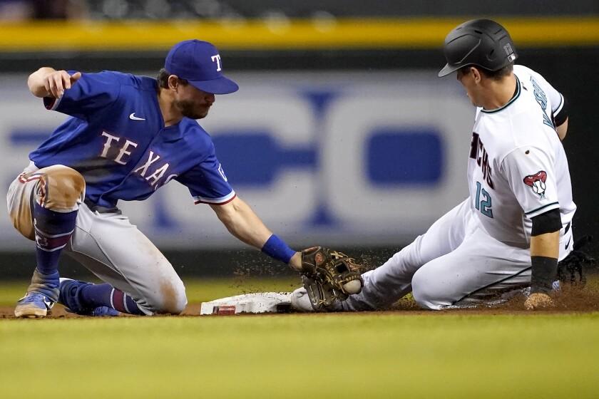 Arizona Diamondbacks' Daulton Varsho (12) steals second as Texas Rangers' Nick Solak is late with the tag during the third inning of a baseball game, Tuesday, Sept. 7, 2021, in Phoenix. (AP Photo/Matt York)