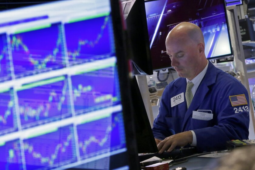 Specialist John O'Hara works at his post on the floor of the New York Stock Exchange, Wednesday, Aug. 26, 2015. U.S. stocks closed sharply higher, giving the stock market its best day in close to four years. The Dow Jones industrial average climbed 619 points, or 4 percent on Wednesday. (AP Photo/Richard Drew)
