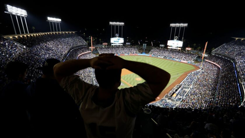 LOS ANGELES, CALIF. --WEDNESDAY, NOV. 1, 2017: A Dodgers fan shows his frustration in the fifth inn