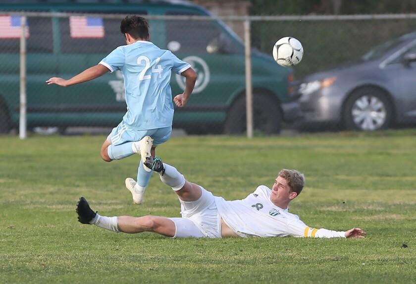 Edison's Wyatt Burris (8) disrupts a shot on goal from CdM's Taylor Demarais in Surf League soccer m