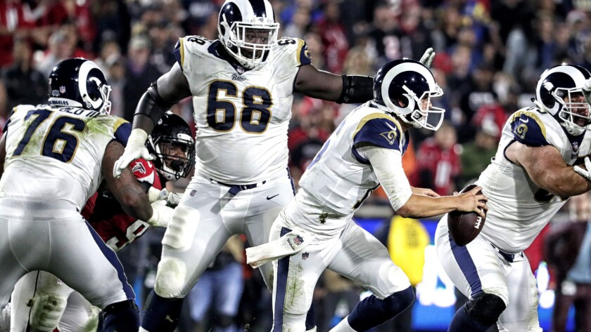 LOS ANGELES, CA, SATURDAY, JANUARY 6, 2018 - Rams quarterback Jared Goff scrambles away from pressur