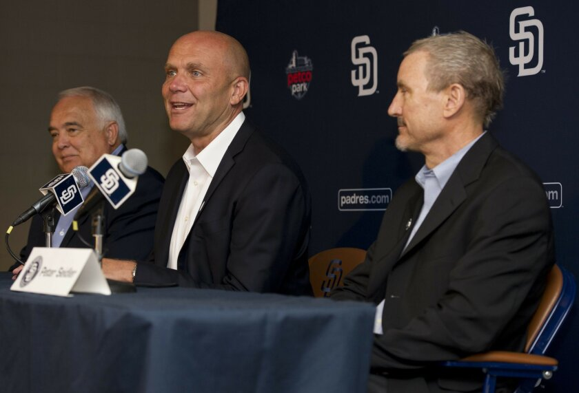Padres President and CEO Mike Dee, center, answers questions during a press conference at Petco Park on Tuesday, August 20th, 2013. To the left is Padres Executive Chairman Ron Fowler and to the right is Padres lead investor Peter Seidler.
