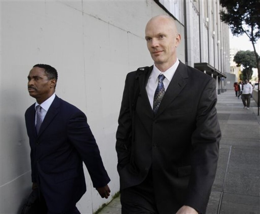 Federal Agent Jeff Novitzky, right, is seen at the federal courthouse in San Francisco, Monday, March 21, 2011. (AP Photo/Marcio Jose Sanchez)