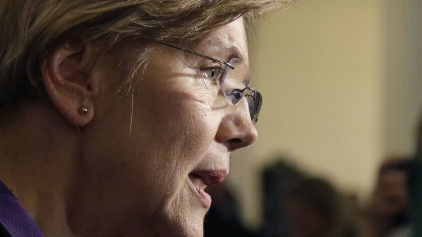 Sen. Elizabeth Warren, D-Mass., speaks to reporters at the Massachusetts Statehouse on Jan. 2.