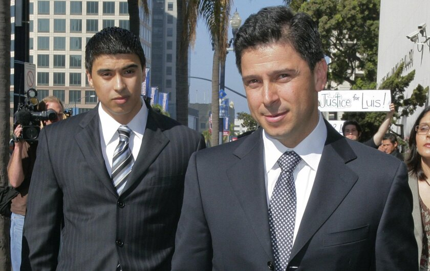 In this Wednesday March 18, 2009 file photo, former California Assembly Speaker Fabian Nunez, right, and his son Esteban Nunez, left, leave a hearing in Superior Court in San Diego.
