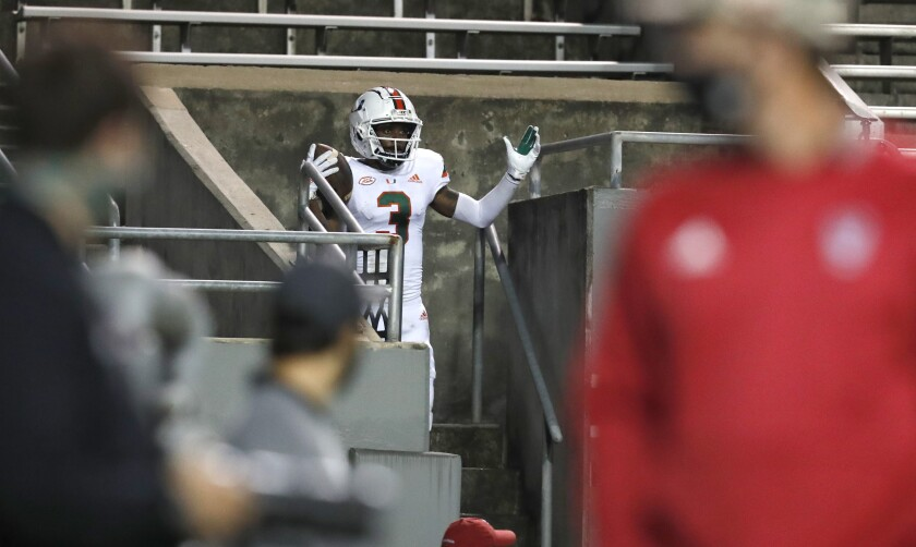 Miami wide receiver Michael Harley celebrates after running into the stands following a touchdown reception Nov. 6, 2020.