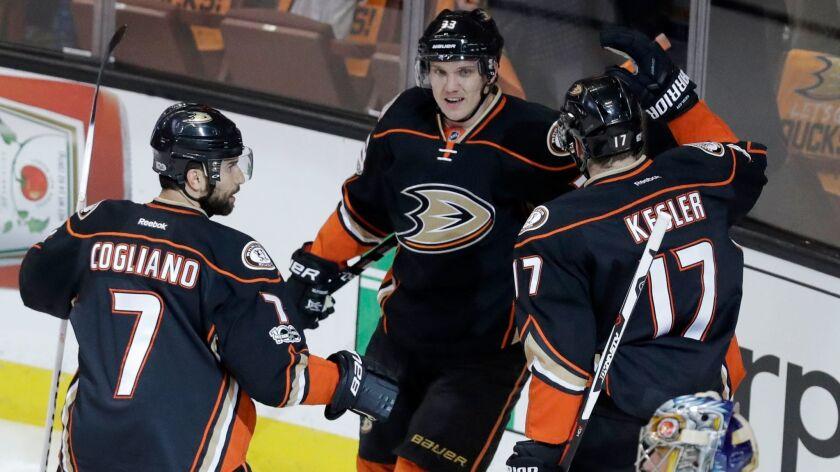 Anaheim Ducks' Andrew Cogliano (7) and Ryan Kesler (17) celebrate after Jakob Silfverberg, center, s