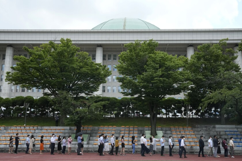 People queue in line to wait for the coronavirus testing at a makeshift testing site at the National Assembly in Seoul, South Korea, Thursday, July 15, 2021. South Korea has added 1,600 more coronavirus cases, with infections spreading beyond the hard-hit capital area where officials have enforced the country's toughest social distancing restrictions. (AP Photo/Ahn Young-joon)
