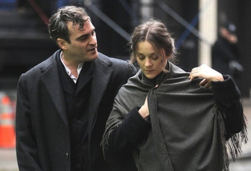 "Joaquin Phoenix and Marion Cottilard in James Gray's ""The Immigrant."""
