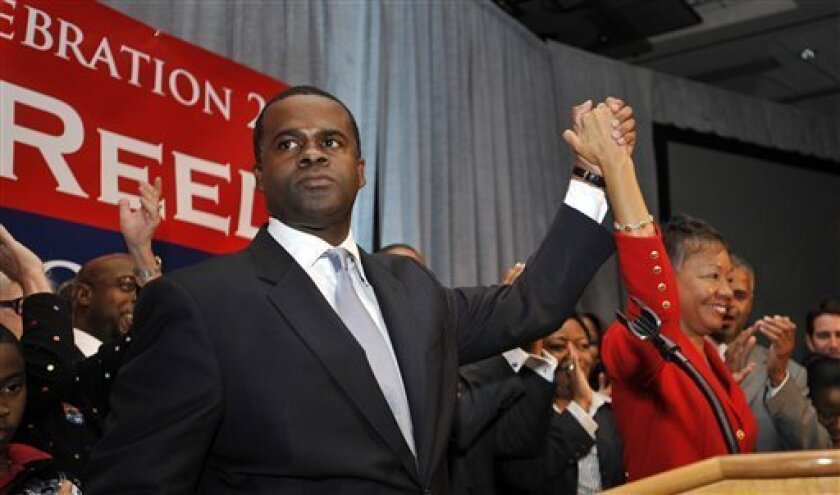 FILE - In this Dec. 1, 2009 file photo, Atlanta Mayoral candidate Kasim Reed, left, celebrates with Lisa Borders, Atlanta city council president, center, during his runoff Election Night Party in Atlanta. When the final votes are counted, it's likely the black political machine that integrated Atlanta's City Hall _ and kept it that way for four decades _ will have pulled through one more time to deliver a fifth consecutive black mayor. Barely. (AP Photo/Gregory Smith, File)