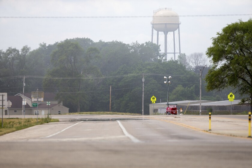 Smoke from the Chemtool industrial fire wafts across Nazarene Drive Tuesday, June 15, 2021, in Rockton, Ill., creating a haze over a neighborhood. (Scott P. Yates/Rockford Register Star via AP)
