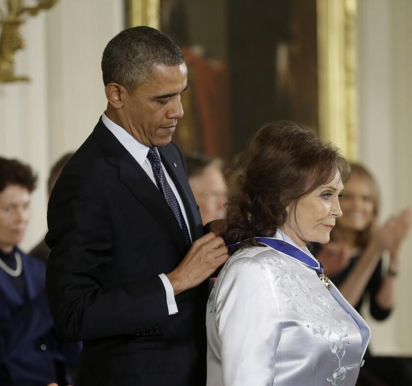 Barack Obama and Loretta Lynn