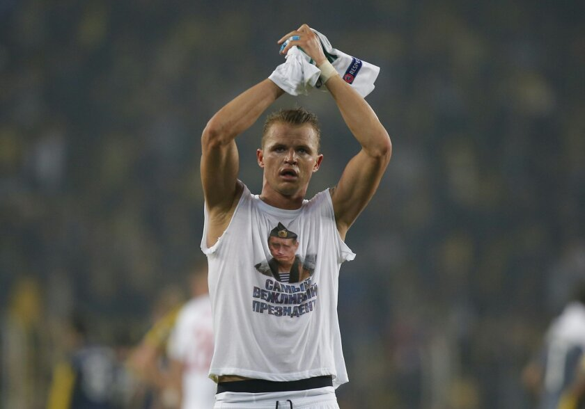 """Locomotiv Moscow's Dmitri Tarasov features an inner shirt with a picture of Russian President Vladimir Putin and the slogan """"The most polite President"""",  following a Europa League first leg round of 32, soccer match against Fenerbahce in Istanbul, Tuesday, Feb. 16, 2016. Fenerbahce won the match 2-"""