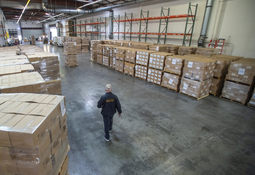 Workers at an L.A. County warehouse handle the coordination and distribution of medical supplies for hospitals and health facilities across the county.