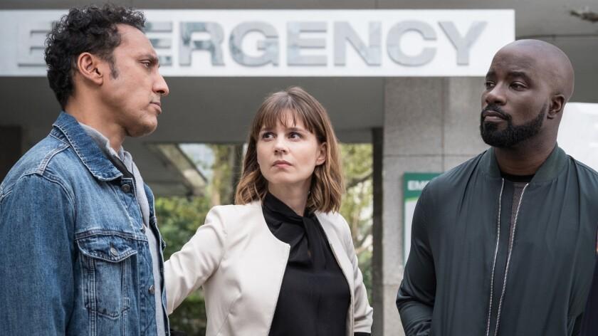 "Aasif Mandvi, left, Katja Herbers and Mike Colter in ""Evil"" on CBS."