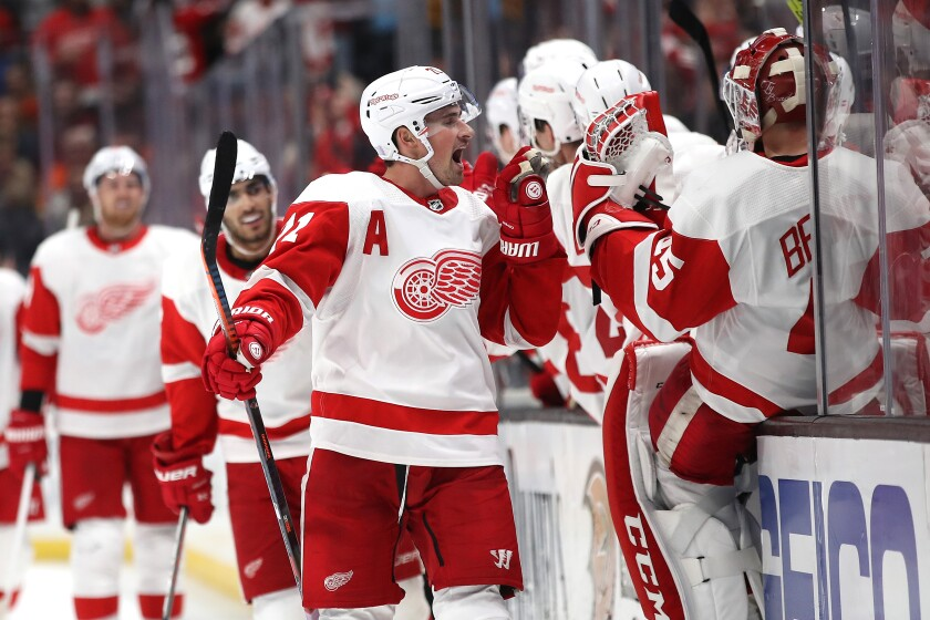 Dylan Larkin gets the Red Wings' bench going after scoring a goal against the Ducks on Nov. 12 at Honda Center.