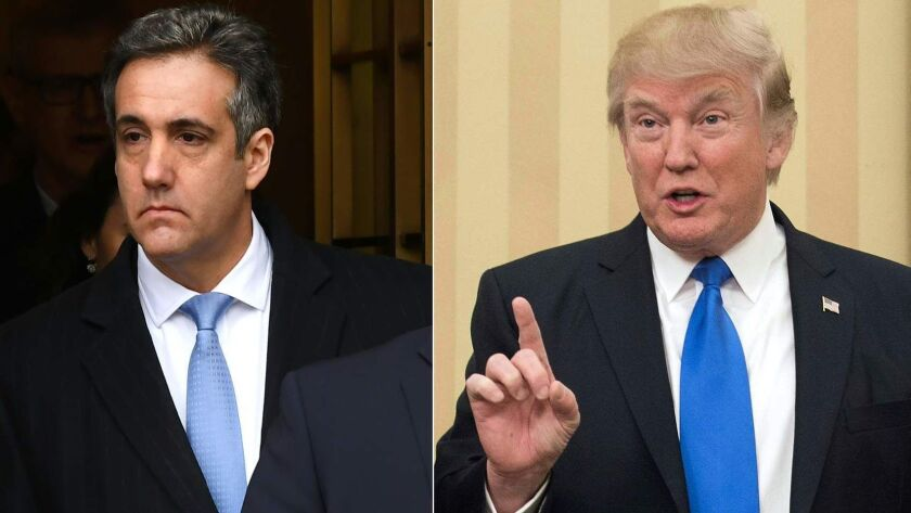 Michael Cohen, left, and President Trump, shown speaking at the White House on Feb. 1, 2017.