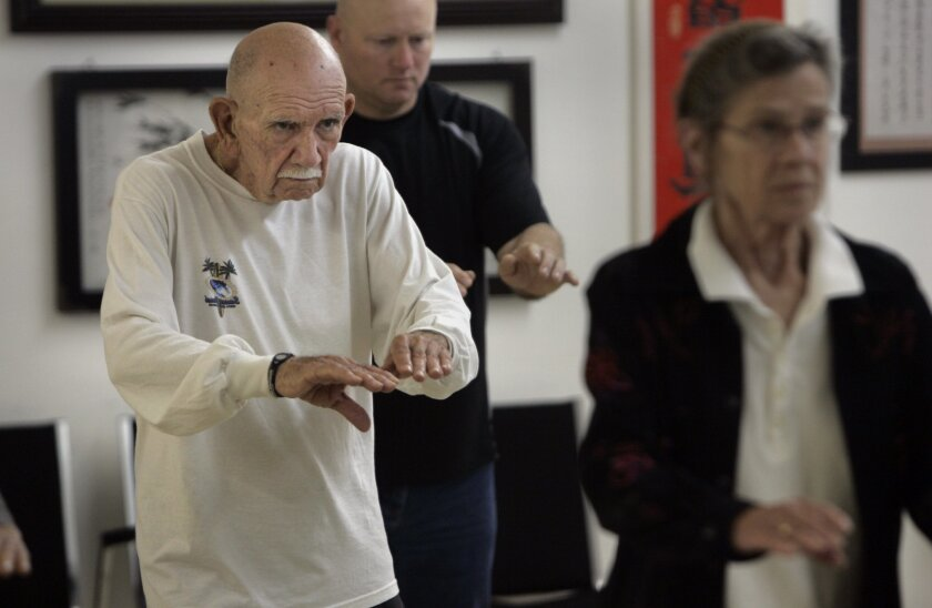 """In this April photo, Don Gonsalves, 78, left, participates in a Tai Chi class at the Clairemont Tai Chi Wellness Center. In the background is Bill Cherry, 48, and foreground right is Penelope """"Penny"""" Drawbridge, 72."""