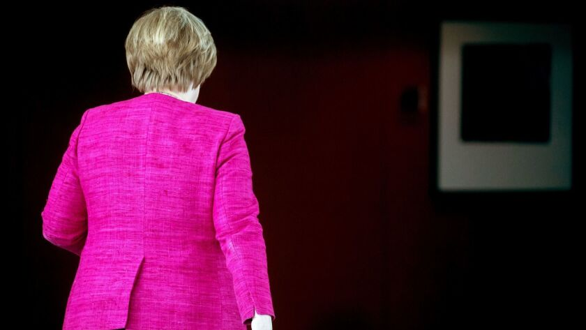 A picture taken on June 15 shows German Chancellor Angela Merkel walking to her office after a meeting in Berlin.