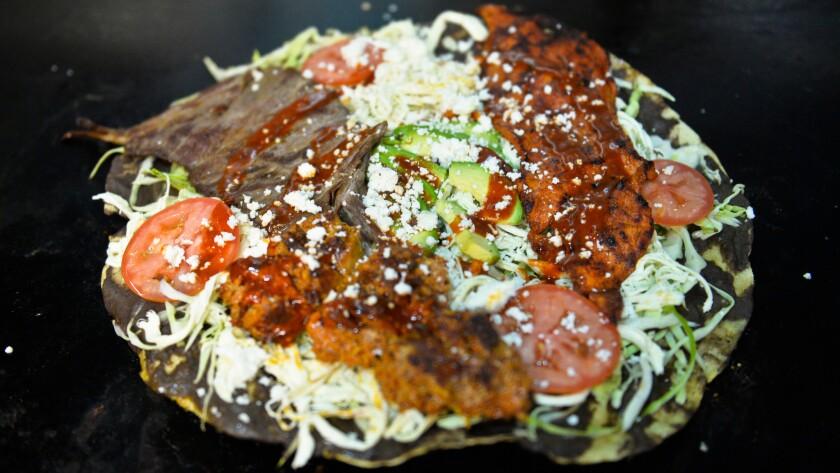 The Tlayuda dish at Aqui es Oaxaca off Venice Blvd in Los Angeles ready to serve.