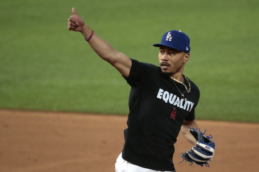 "Dodgers right fielder Mookie Betts wears an ""Equality"" jersey during workouts before Game 1 of the NLCS."