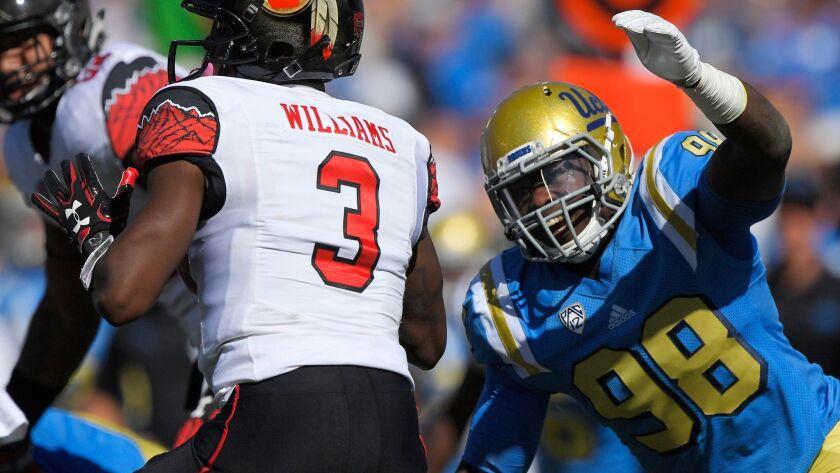 UCLA's Takkarist McKinley move in to sack Utah quarterback Troy Williams on Oct. 22.