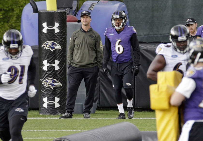 Baltimore Coach John Harbaugh and wide receiver Keenan Reynolds watch a drill during rookie minicamp May 7.