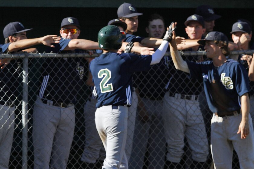 La Costa Canyon players (shown celebrating a hit earlier this season) had plenty to cheer in Tuesday's playoff win over top-seeded Rancho Bernardo.