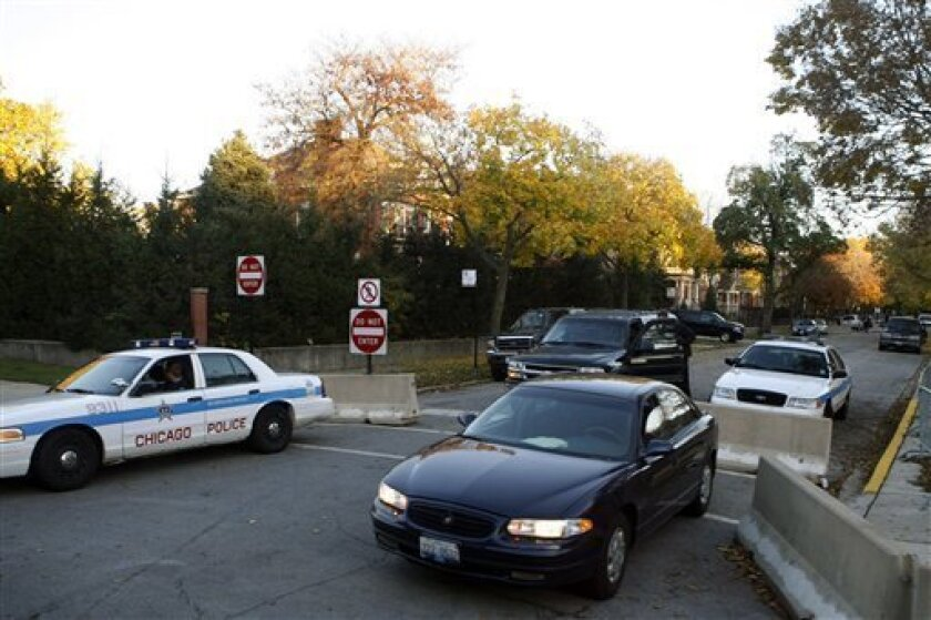 In this Nov. 6, 2008, file photo, the Hyde Park neighborhood home of President-elect Barack Obama is protected with added security on the surrounding streets leading to the house in Chicago. When Obama heads home for a break from the White House, he won't go to a sprawling ranch or private seaside compound, he will return to a crowded city neighborhood, creating different security challenges for the Secret Service and perhaps headaches for his neighbors. (AP Photo/Pablo Martinez Monsivais, File)