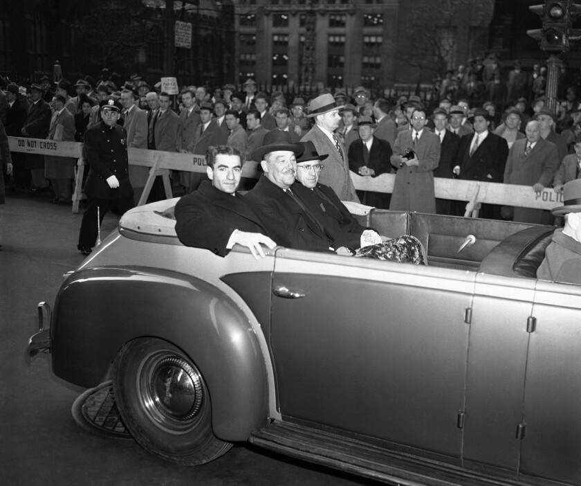 """FILE - In this Nov. 21, 1949, file photo, Shah Mohammad Reza Pahlavi of Iran, left, Grover Whalen, representing the Mayor of New York, center, and Hussein Ala, Iranian Ambassador to the U.S., right, ride through Broadway on their way to an official reception for Pahlavi at City Hall, in New York. It wasn't always the case of venturing into """"enemy"""" territory for Iranian leaders when they visited the United Nations in New York. Shah Mohammad Reza Pahlavi was a key U.S. ally for decades. (AP Photo/File)"""