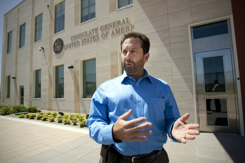 Steven Kashkett, the U.S. consul general in Tijuana, stands outside the new facility that opened this week.