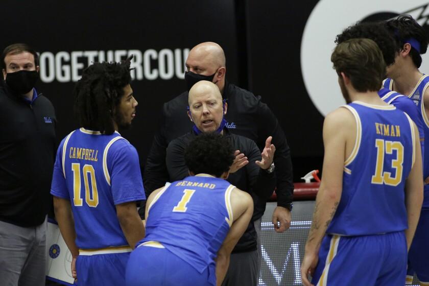 UCLA players gather around their coach