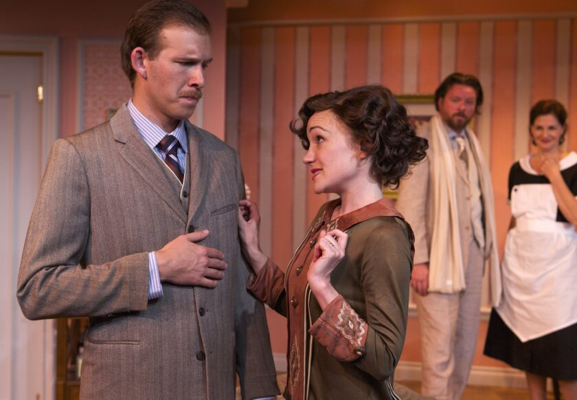 In the background, Maurice (Richard Baird) and Saunders (Jacquelyn Ritz) eavesdrop on the intimate conversation of Fred (Thomas Miller) and his wife Julia (Joanna Strapp). Fallen Angels' plays Sept. 3-28, 2014 at North Coast Rep Theatre in Solana Beach.