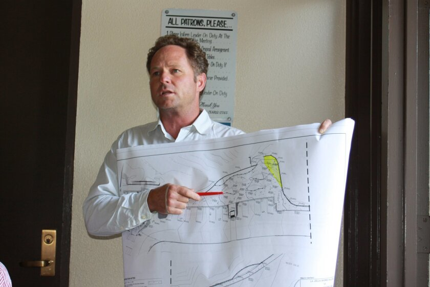 Landscape architect Jim Neri presents revised plans for the Children's Pool Walk beautification project.