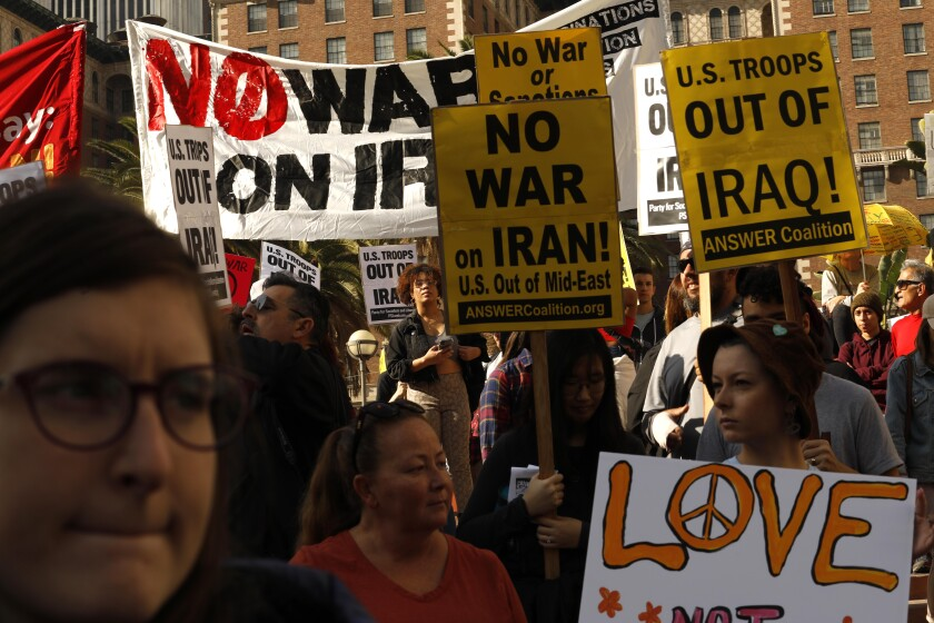 Around 300 people take part in a National Day of Protest in Pershing Square on Jan. 4, voicing their opposition to war with Iran days after a top Iranian military commander was killed in a U.S. airstrike in Baghdad.