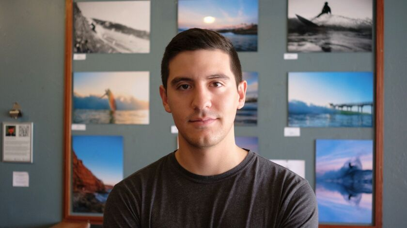 Luis Ortega poses with some of his waterscapes