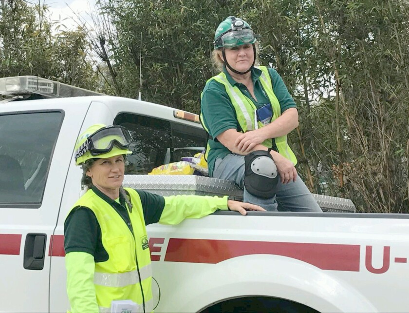Michelle Scott, left, represents the Community Emergency Response Team (CERT) as a volunteer with Teresa O'Donnell during a Ramona Rodeo Parade. Scott is receiving care for a brain injury she suffered as a result of a vehicle collision while riding her bike Oct. 2.