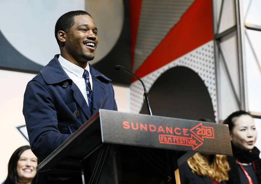 "Director Ryan Coogler accepts the U.S. Dramatic Audience Award for the film ""Fruitvale"" during the 2013 Sundance Film Festival awards ceremony."