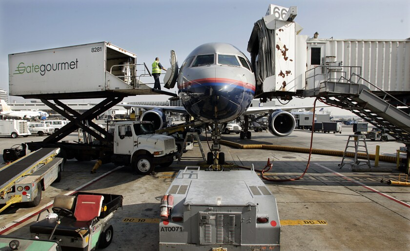 Workers for Gate Gourmet, which provides janitorial service for Delta Airlines at LAX, have sued. They claim they were barred from speaking Spanish in the workplace.