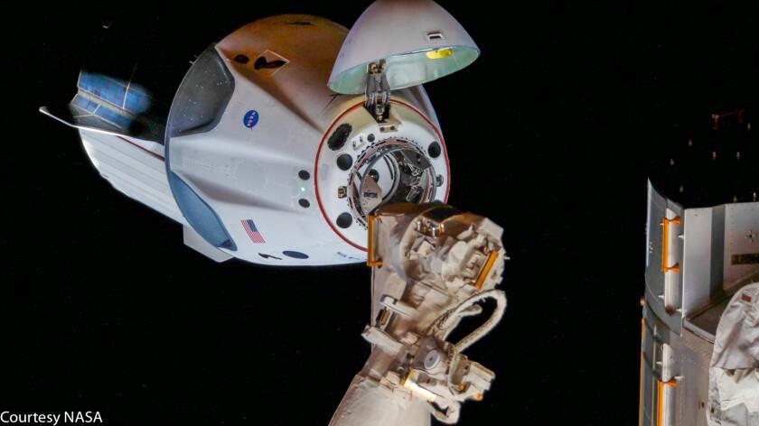 Doug Hurley and Bob Behnken aboard Crew Dragon docking with ISS (May 31, 2020)