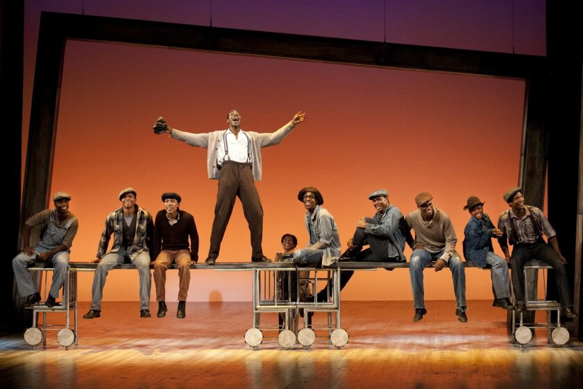 Haywood Patterson (Clifton Duncan) energizes his buddies about to take a train trip that alters their lives in 'The Scottsboro Boys' at The Old Globe Theatre. Photo Henry DiRocco.