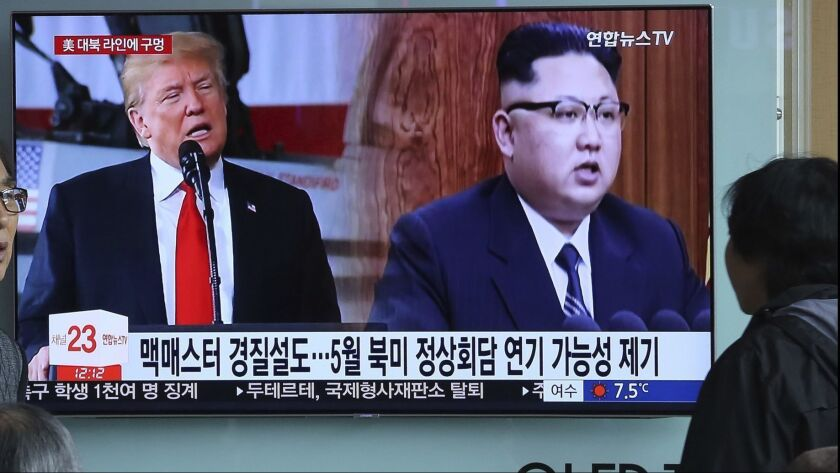 President Trump and North Korean leader Kim Jong Un on a TV monitor at the Seoul Railway Station on March 17. Trump and Moon, are both planning to meet Kim this spring.