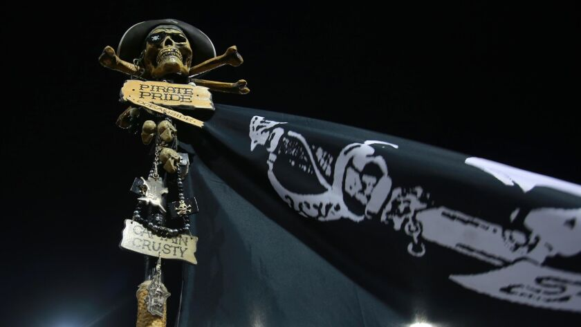 Once a pirate, always a pirate. The Oceanside flag flies next to the team's bench during the homecoming game Friday night.