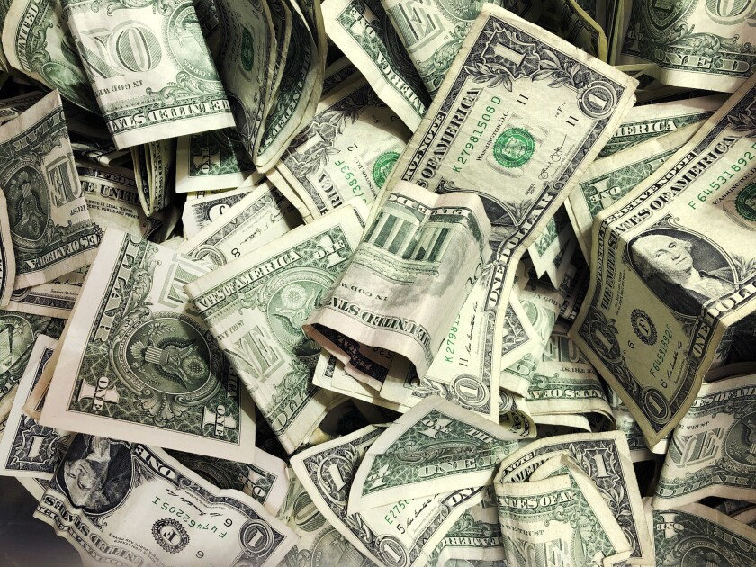 A pile of dollar bills.