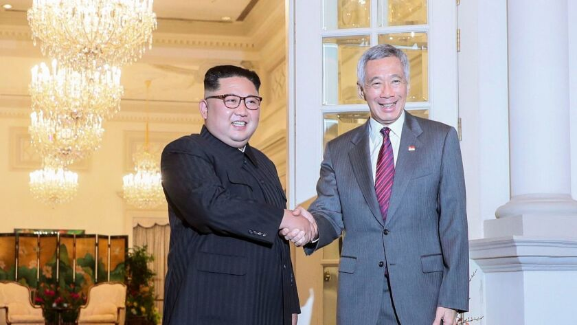 North Korean leader Kim Jong-un, left, and Singapore Prime Minister Lee Hsien Loong meet Sunday at the Istana Presidential Palace in Singapore.