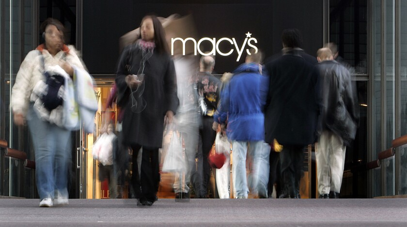 This 2008 photo shows pedestrians walking in and out of Macy's in downtown Minneapolis.