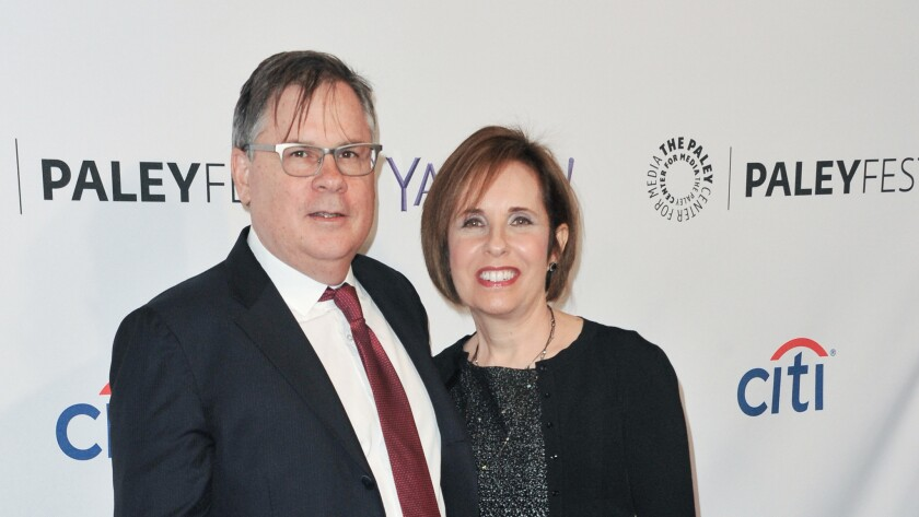 Robert King and Michelle King arrive at an event in 2015.