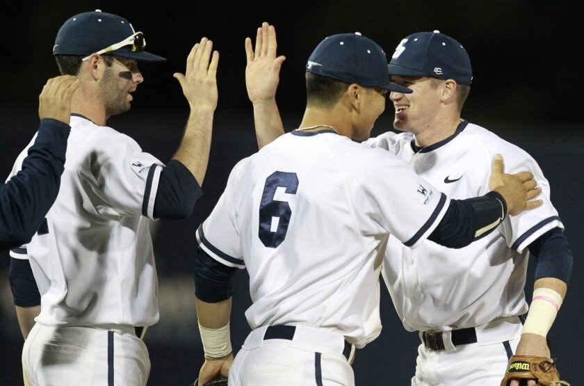 USD players, from left, Andrew Daniel, Connor Joe, and Kyle Holder, celebrate the Toreros 7-1 victory over the Aztecs.